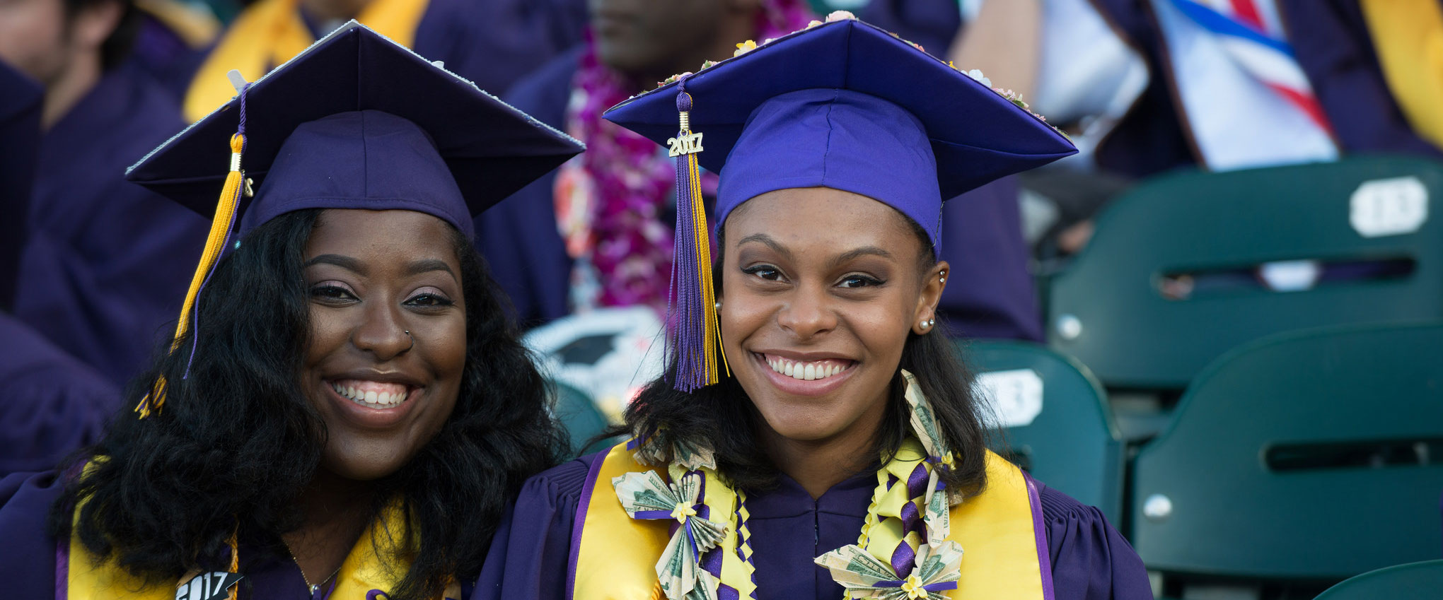 Two female students at graduation