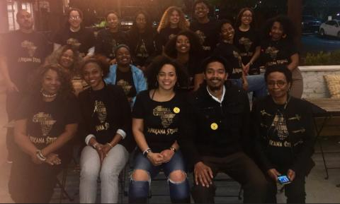 SF State poses for family dinner in Africana Studies T-Shirts